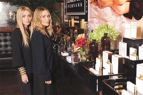 Mary-Kate and Ashley Olsen with perfumes.jpg